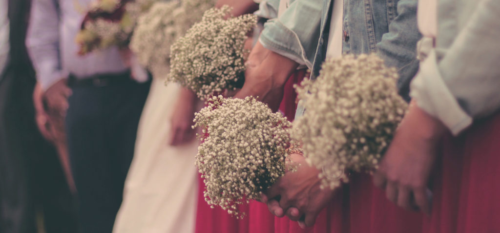 fun activities in the wedding, bridesmaids holding bouquets in red dresses