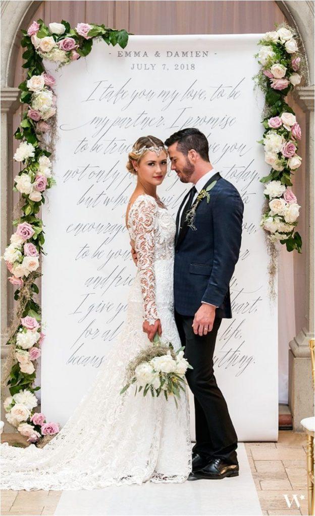 wedding couple against photo call
