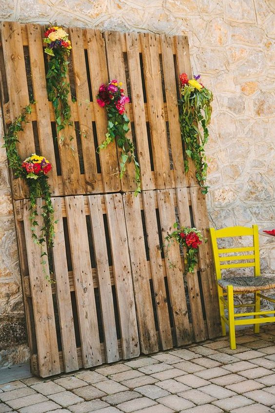 Four wooden crates attached together to create a display and decorated with fresh flowers