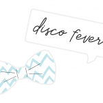 """A card bow tie and a sign that says """"disco fever"""" to use as photo booth props"""